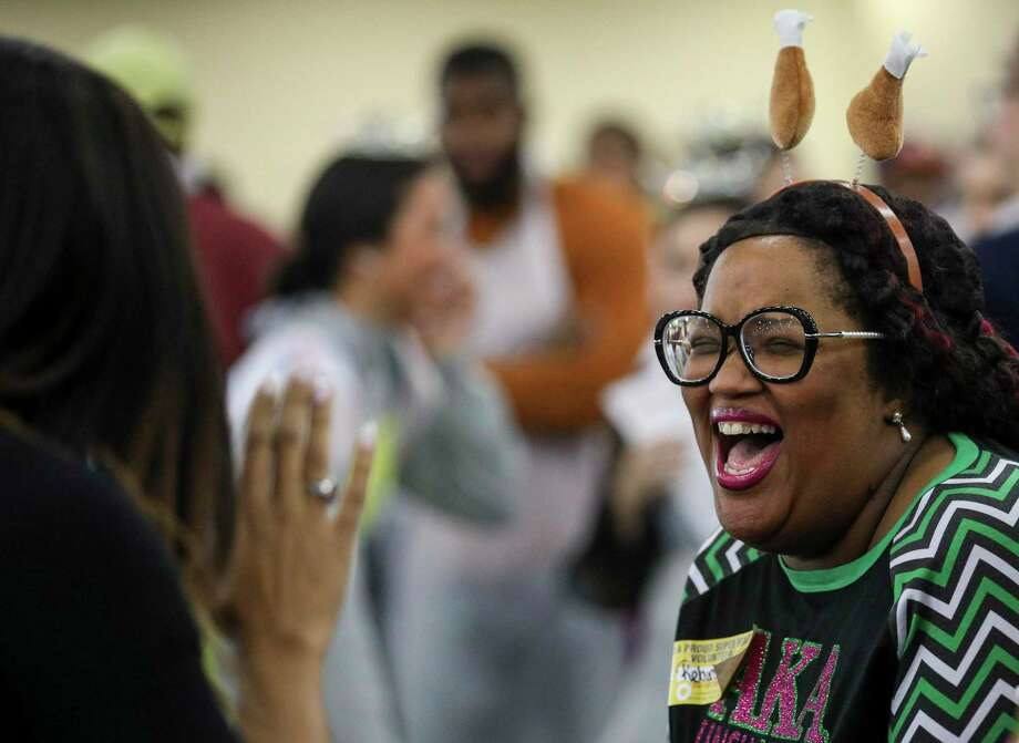 """It's because I'm blessed with food, shelter and life and health, so why not give back?"" asked Rebecca Savoy before serving food for her 21st year at the 41st annual Big Super Feast at the George R. Brown Convention Center on Thursday, Nov. 28, 2019, in Houston. Savoy said she started volunteering at the feast when she was in high school after a teacher urged her to do it. Photo: Jon Shapley, Houston Chronicle / Staff Photographer / © 2019 Houston Chronicle"