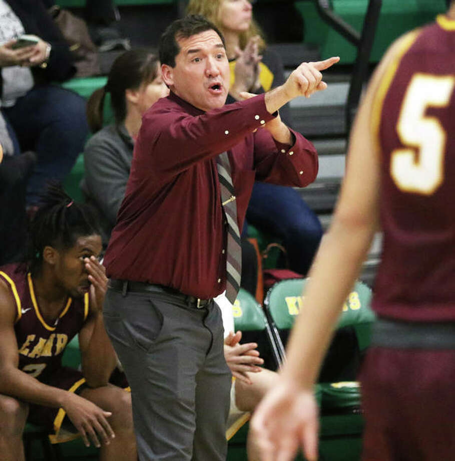 Steve Flowers directs his team during his first game as EA-WR Oilers boys basketball coach on Tuesday at the Metro-East Lutheran Tournament in Edwardsville. After losing Tuesday to Marquette, the Oilers got Flowers his first career victory on Wednesday against Valmeyer. Photo: Greg Shashack / The Telegraph