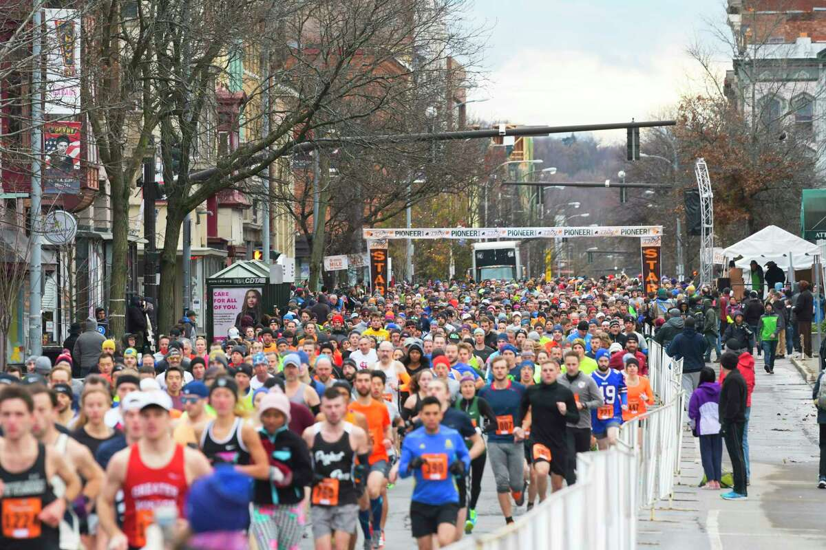 Runners head off from the start along the course during the Troy Turkey Trot 10K race on Thursday, Nov. 28, 2019, in Troy, N.Y. (Paul Buckowski/Times Union)