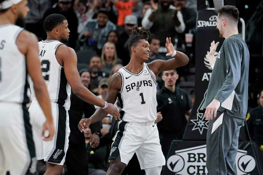 San Antonio Spurs' Lonnie Walker IV (1) is congratulated after scoring by teammates Rudy Gay, left, and Drew Eubanks during the second half of an NBA basketball game against the Minnesota Timberwolves, Wednesday, Nov. 27, 2019, in San Antonio. Minnesota won 113-101. (AP Photo/Darren Abate) Photo: Darren Abate, FRE / Associated Press / Copyright 2019 The Associated Press. All rights reserved.