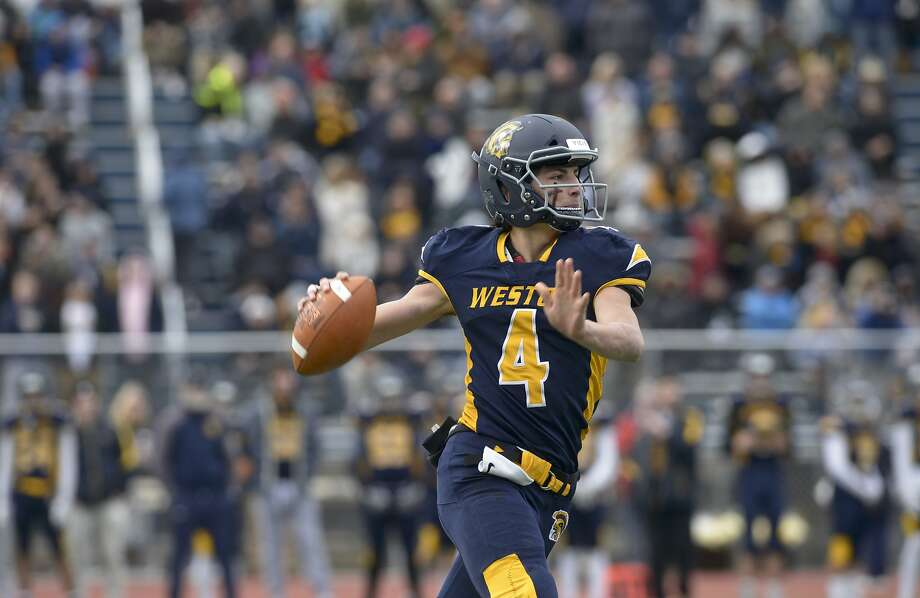 Weston quarterback James Goetz (4) looks down field to throw in the Thanksgiving football game between Joel Barlow and Weston high schools. Thursday, November 28, 2019, at Weston High School, Weston, Conn. Photo: H John Voorhees III, Hearst Connecticut Media