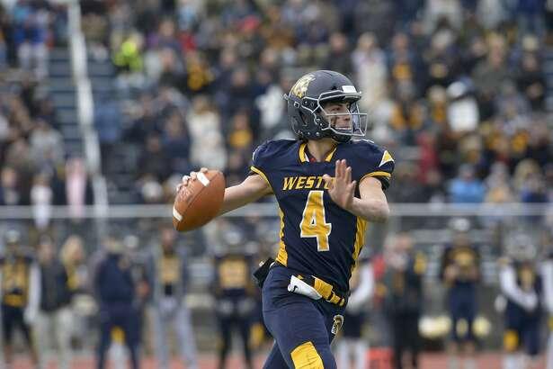 Weston quarterback James Goetz (4) looks down field to throw in the Thanksgiving football game between Joel Barlow and Weston high schools. Thursday, November 28, 2019, at Weston High School, Weston, Conn.