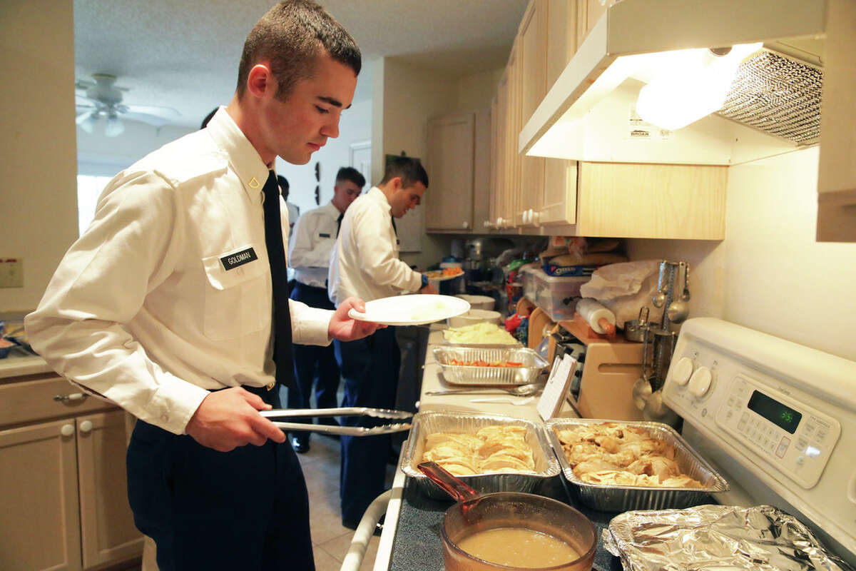 Pfc. Richard Goldman steps up to serve himself as Jan Briggs hosts soldiers from Ft. Sam Houston at her home for Thanksgiving dinner on Nov. 28, 2019.