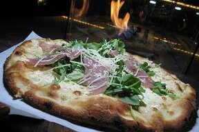 The Pig in the Grass pizza has prosciutto, arugula, truffle oil and mozzarella at 188 South in New Braunfels.