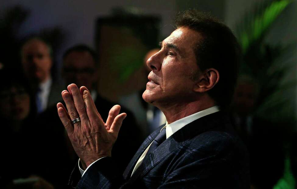 FILE - In this March 15, 2016 file photo, casino mogul Steve Wynn gestures during a news conference in Medford, Mass. Wynn Resorts has agreed to accept $41 million from former CEO and chairman Wynn and insurance carriers as part of a settlement stemming from shareholder lawsuits accusing company directors of failing to disclose the casino mogula€™s alleged pattern of sexual misconduct. The company said in a statement late Wednesday, Nov. 27, 2019, neither the company nor its current or former directors or officers were found to have committed any wrongdoing in connection with the pending settlement. (AP Photo/Charles Krupa, File)