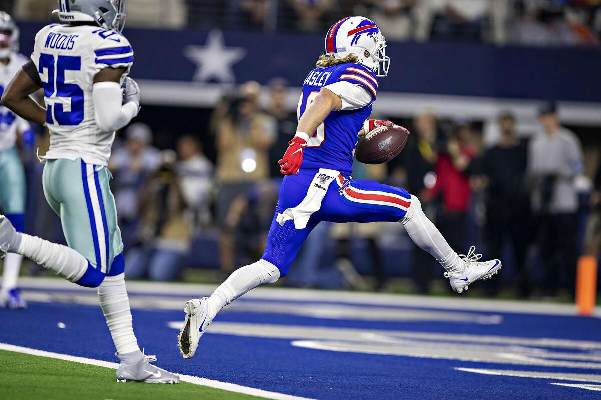 ARLINGTON, TX - NOVEMBER 28: Cole Beasley #10 of the Buffalo Bills runs a pass in for a touchdown in the second quarter on Thanksgiving Day during a game against the Dallas Cowboys at NRG Stadium on November 28, 2019 in Arlington, Texas. (Photo by Wesley Hitt/Getty Images)