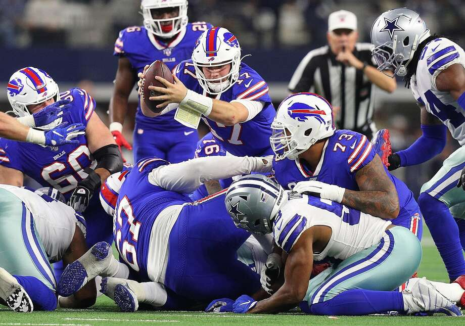 Bills quarterback Josh Allen recovers his own fumble lunges for a first down against the Cowboys. Photo: Richard Rodriguez / Getty Images