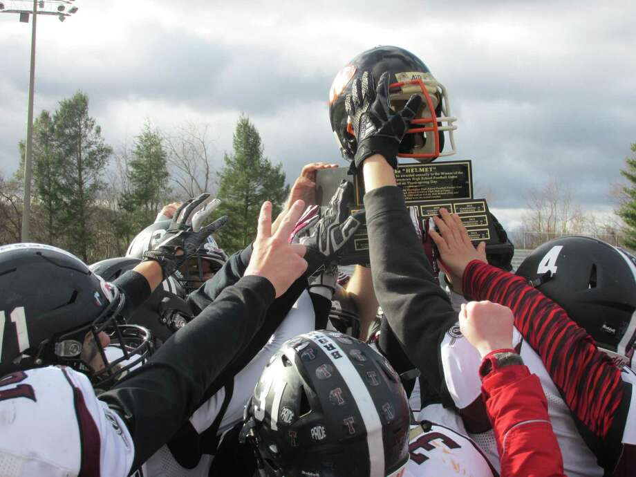Torrington retained The Helmet Trophy in its annual Thanksgiving Day rivalry game with Watertown Thursday morning at Watertown High School. Photo: Peter Wallace / For Hearst Connecticut Media