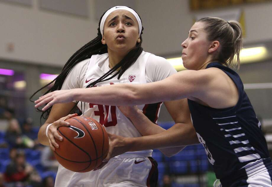 Stanford's Haley Jones goes to the basket as California Baptist's Georgia Dale defends during the first quarter Thursday in Victoria, British Columbia. Photo: Chad Hipolito / Associated Press