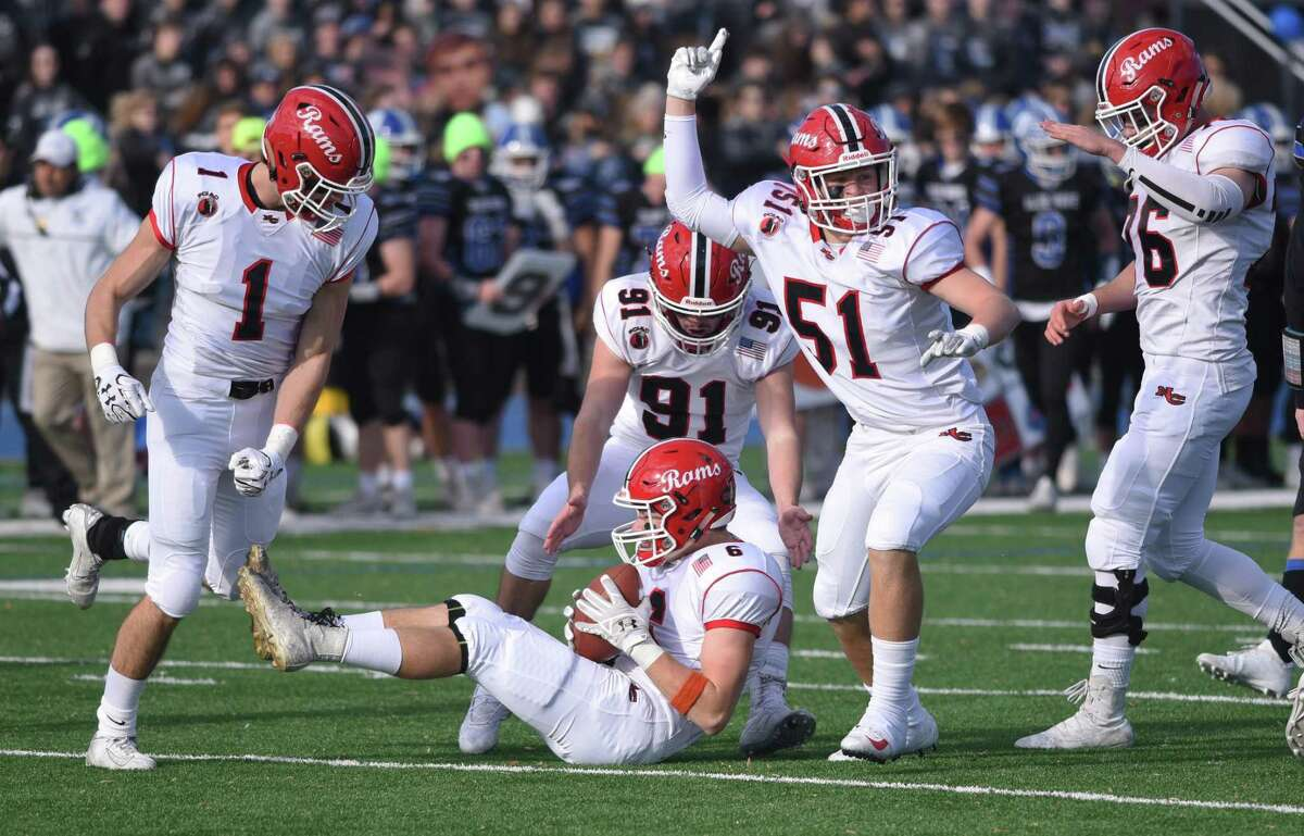 New Canaan's Andrew Morse (6) recovers a fumble during the annual Turkey Bowl against Darien last week.