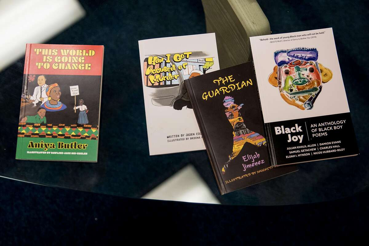 Novels created by students of former years sit on a table in the Writer's Room of Chapter510 at Westlake Middle School in Oakland, Calif. Friday, Nov. 22, 2019.