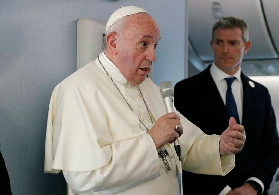 Pope Francis speaks during a news conference onboard the papal plane on his flight back from a trip to Thailand and Japan, Monday, Nov. 26, 2019. (Remo Casilli/Pool Photo via AP) / Copyright 2019 The Associated Press. All rights reserved