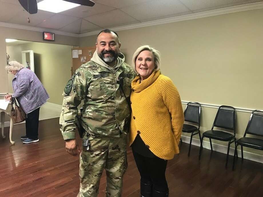 Lt. Jaime Salinas, with the Plainview Police Department, stands with PARSPA member Terry Miller. Salinas gave a presentation to the Plainview Area Retired School Personnel Association about Plainview Area's SWAT team during its monthly meeting Tuesday. Photo: Courtesy Photo/PARSPA