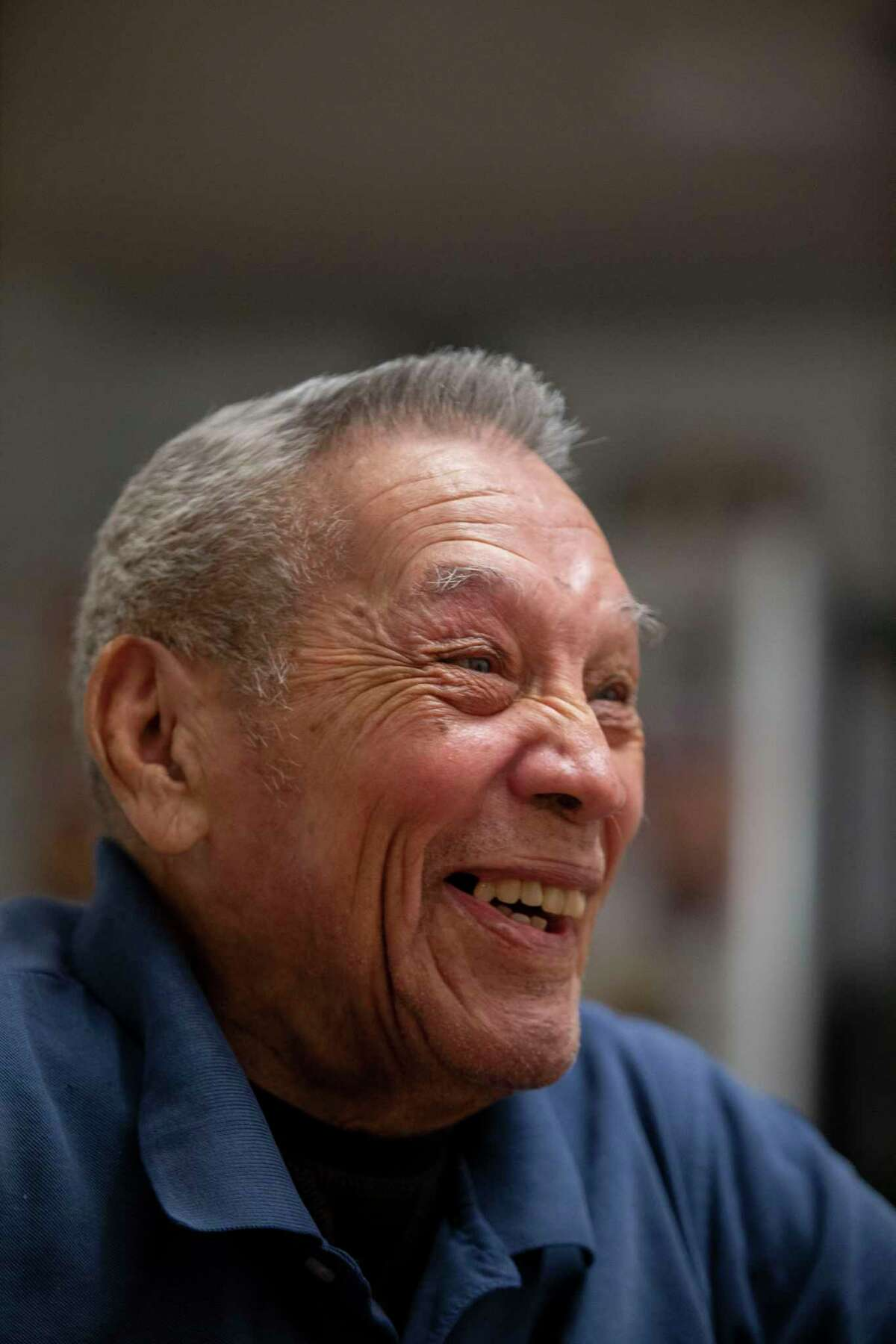 """Willie Doria, 94, one of the last living stars of the Spanish American Baseball League, poses at the home of Joe Sanchez, a former manager of the league, in San Antonio, Texas on Nov. 26, 2019. Doria's favorite part of the game is hitting home runs and friends say he hit his best home run when he was 65. """"The only thing I can tell you is that I have good eyesight,"""" says Doria as he explains his skill. """"Each pitcher has a style and I used to watch their fingers and how they held the ball and I knew exactly what was coming."""""""
