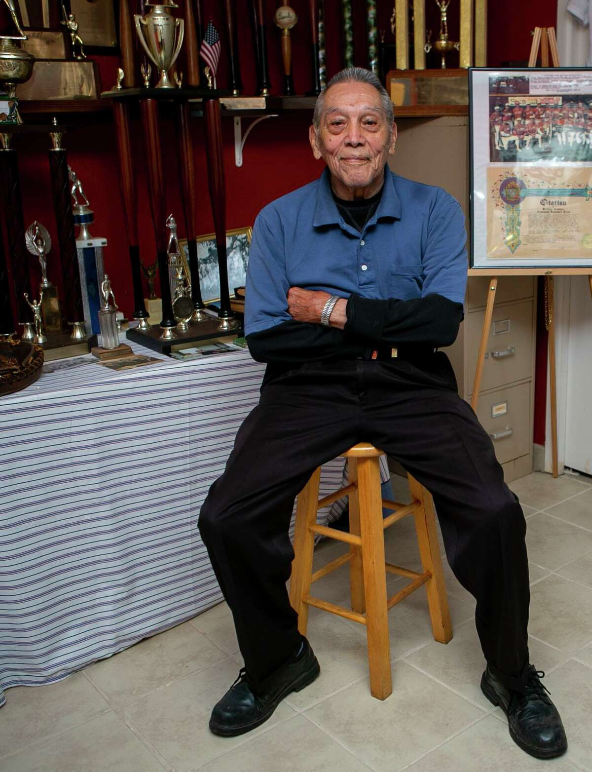 Willie Doria, 95, is one of the last living stars of the Spanish American Baseball League, poses at home of Joe Sanchez, a lifelong friend and the former manager of the league, in San Antonio, Texas on Nov. 26, 2019.