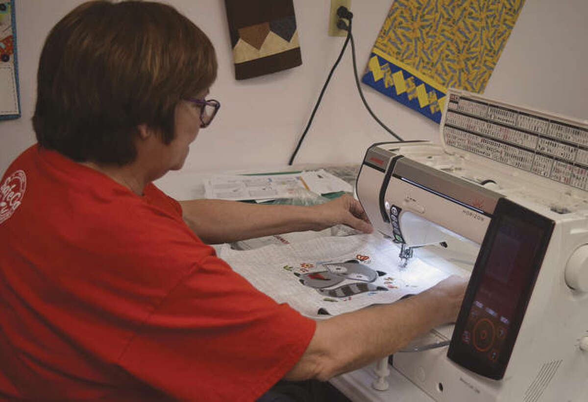 Barb Chumley of Times Square Sewing in downtown Jacksonville prepares for the weekend holiday shopping.