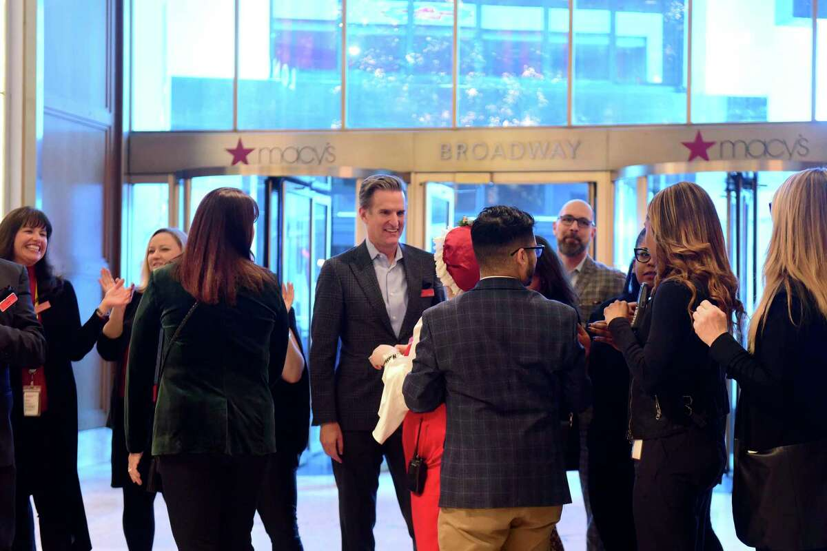 IMAGE DISTRIBUTED FOR MACY'S - Jeff Gennette, center, Chairman and CEO of Macy's, Inc., prepares for Macy's Herald Square to open its doors at 5 p.m. on Thanksgiving Day for thousands of Black Friday shoppers, Thursday, Nov. 28, 2019 in New York. (Diane Bondareff/AP Images for Macy's)