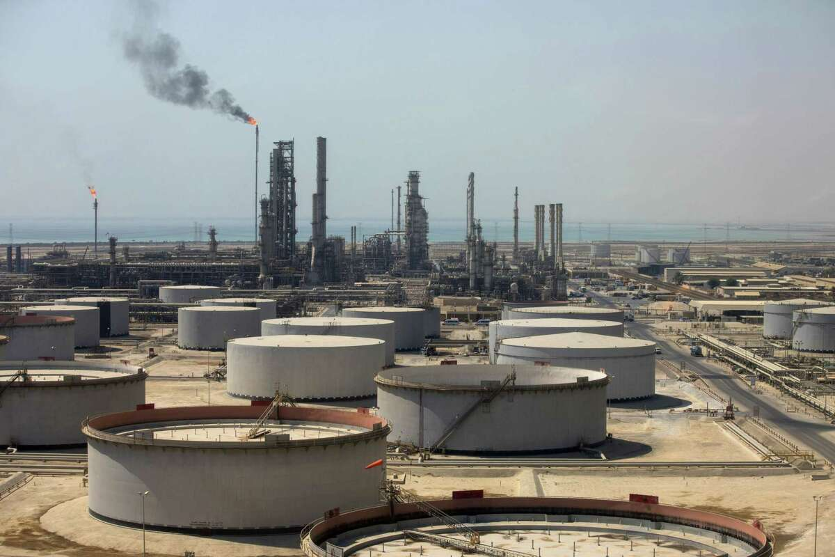 Crude oil storage tanks stand at the oil refinery operated by Saudi Aramco in Ras Tanura, Saudi Arabia, on Oct. 1, 2018.