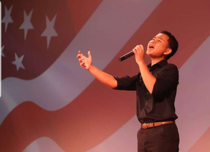 Lee Reh sings the National Anthem at the Palace Theatre in Albany prior to the Albany School District's Golden Apple awards ceremony on Sept. 6. The ceremony recognizes district employees. (credit: Lisa Angerame)
