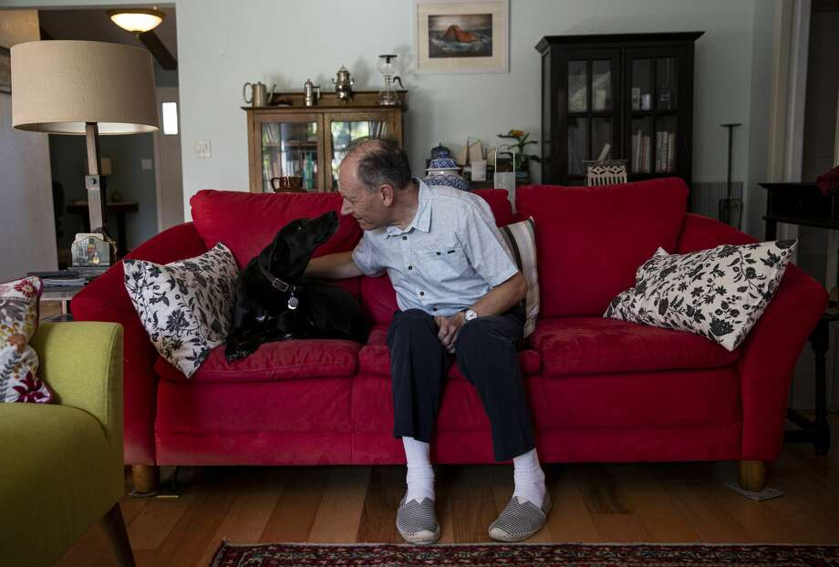 Clive Wynne, a psychologist at Arizona State University, at home with his dog, Xephos, who loves him very much. Photo: ADRIANA ZEHBRAUSKAS/NYT