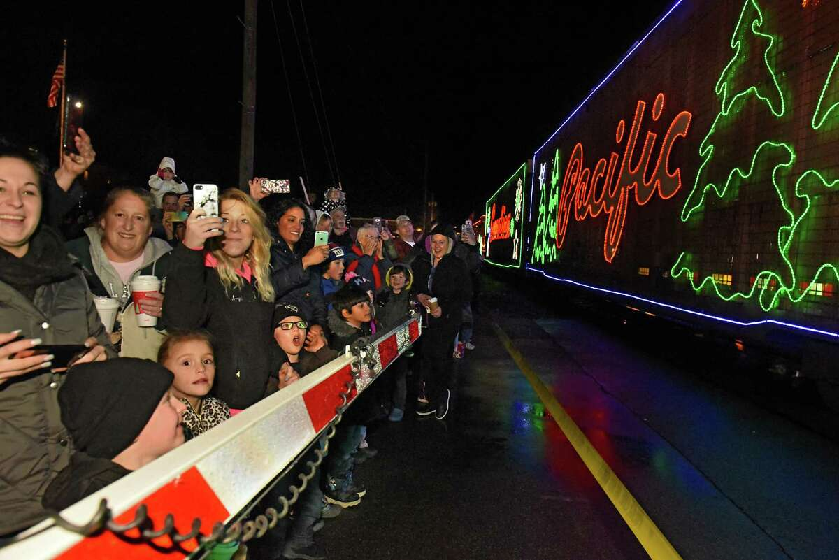 Families cheer as the Canadian Pacific train, decked in Christmas lights in Mechanicville. (archive photo)