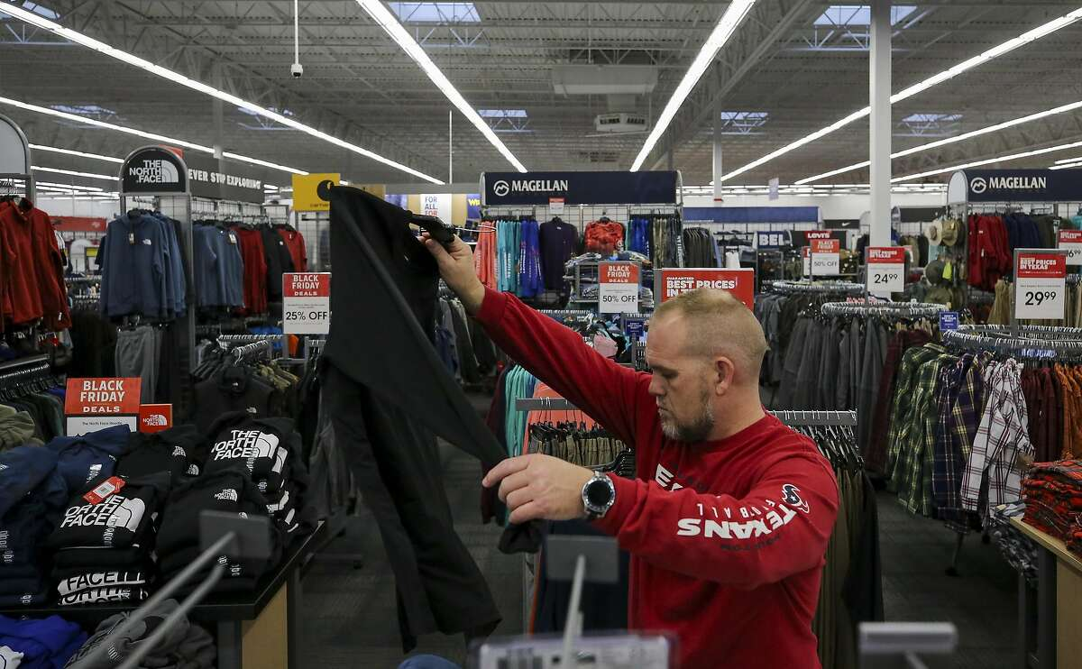 A man shops for Black Friday deals at Academy Sports and Outdoors on Friday, Nov. 29, 2019, in Cypress, Texas.