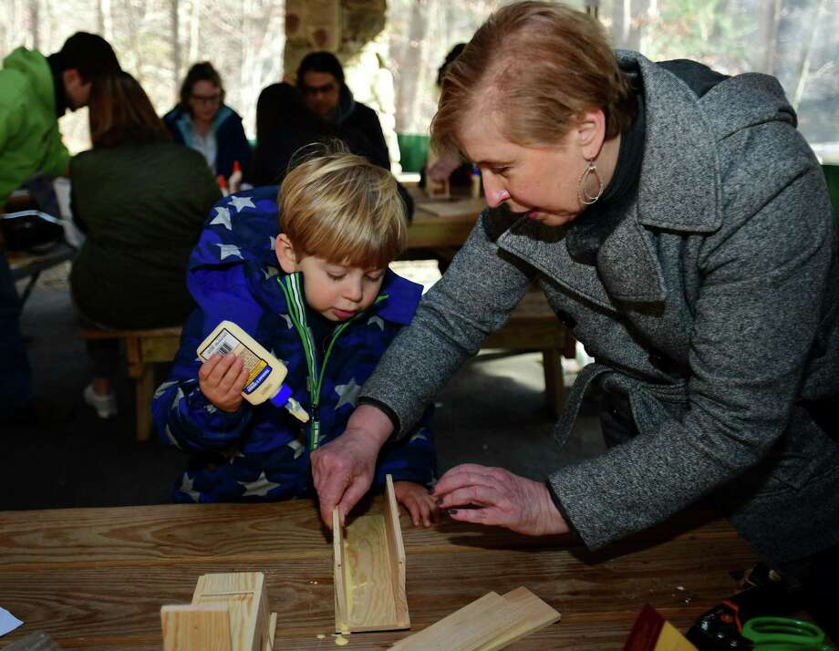 Wilton resident Parker Fensterstock, 3, and grandmother and Weston resident Joce Fensterstoik build bee houses during the Woodcock Nature Center Mason Bee Workshop and Home Building event on Nov. 23 at the center in Wilton. Photo: Erik Trautmann / Hearst Connecticut Media / Norwalk Hour