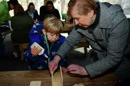 Wilton resident Parker Fensterstock, 3, and grandmother and Weston resident Joce Fensterstoik build bee houses during the Woodcock Nature Center Mason Bee Workshop and Home Building event on Nov. 23 at the center in Wilton.