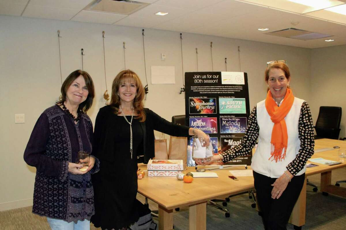 Evi Weintraub, Lisa Passavant and Sandra Miklave, executive director of the Norwalk Symphony Orchestra, at Coldwell Banker Residential Brokerage's first