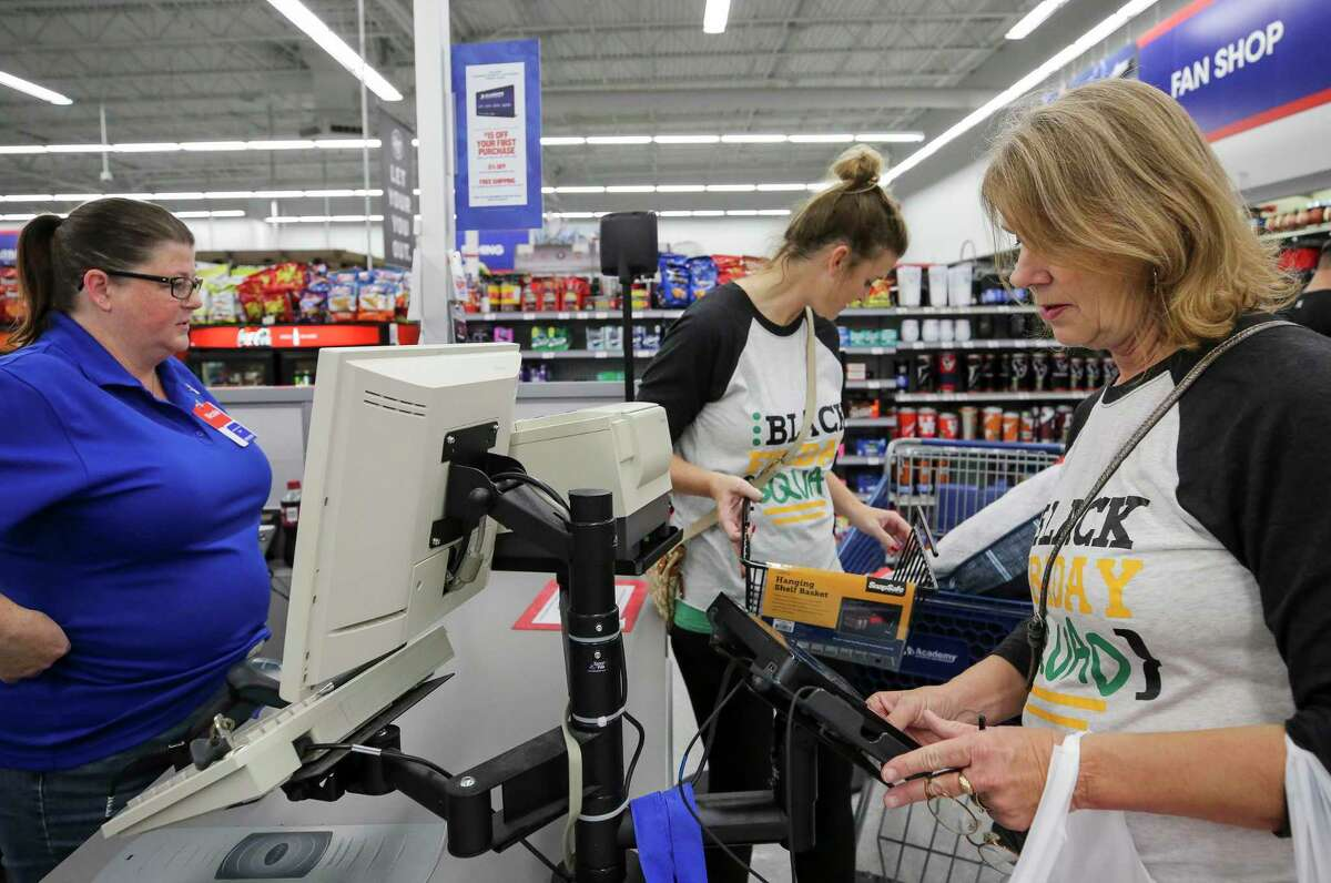 Nancy Conway, 58, pays for her items while shopping Black Friday deals at Academy Sports and Outdoor on Friday, Nov. 29, 2019, in Cypress, Texas. Conway lives in Brenham, Texas, but she and her daughter have been shopping 2 p.m. to 11 p.m. Thursday, and came back out today at 6 a.m.