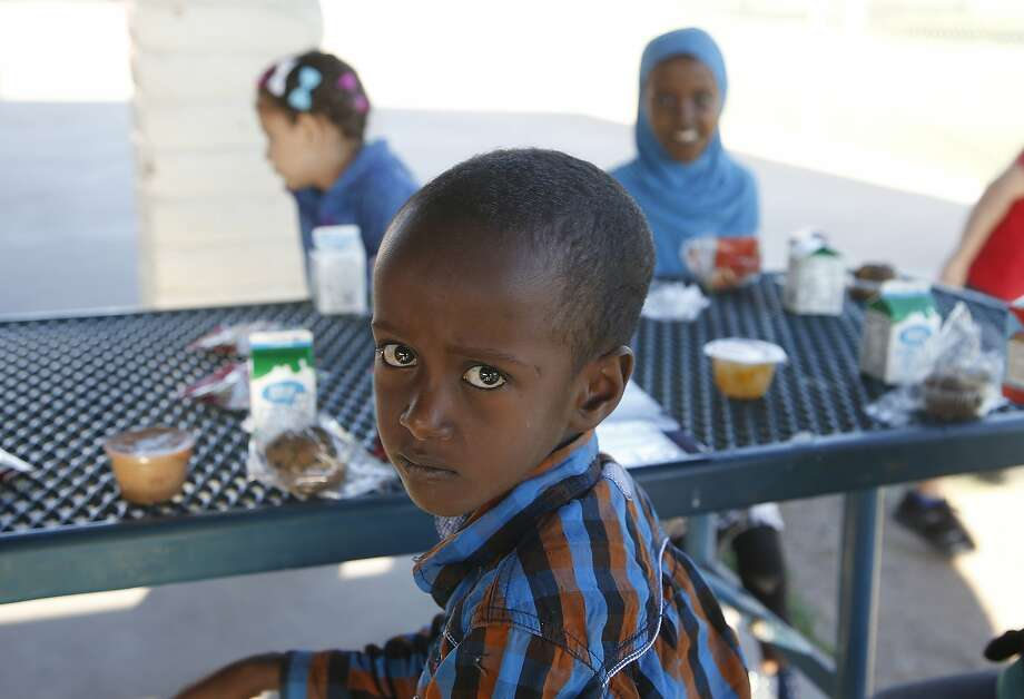 Abdul Ahmed, a second grader at Valencia Newcomer School in Phoenix, has breakfast last month before attending his classes. Photo: Ross D. Franklin / Associated Press