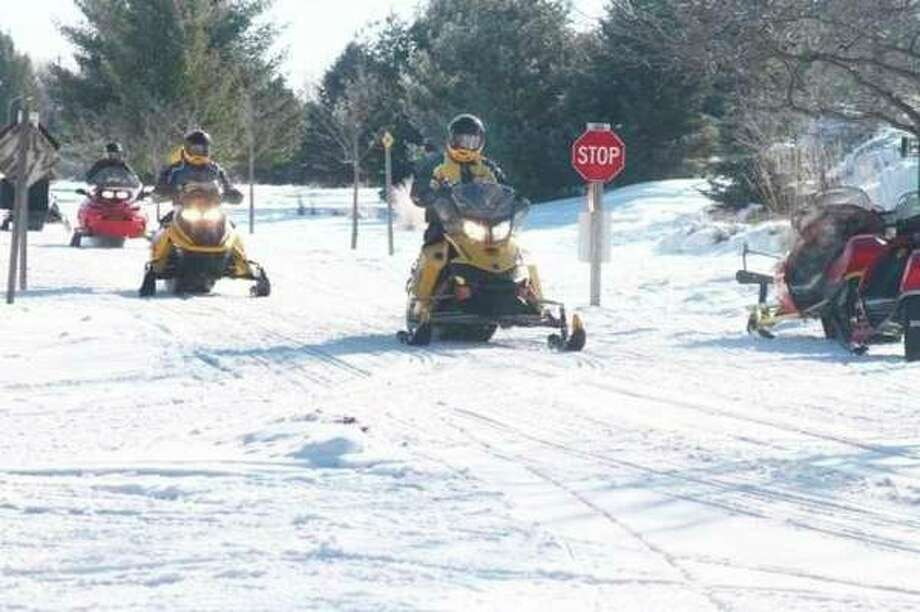 According to the Michigan Department of Natural Resources, state-designated snowmobile trails opened on Sunday, and will remain open until March 31. (Pioneer file photo)