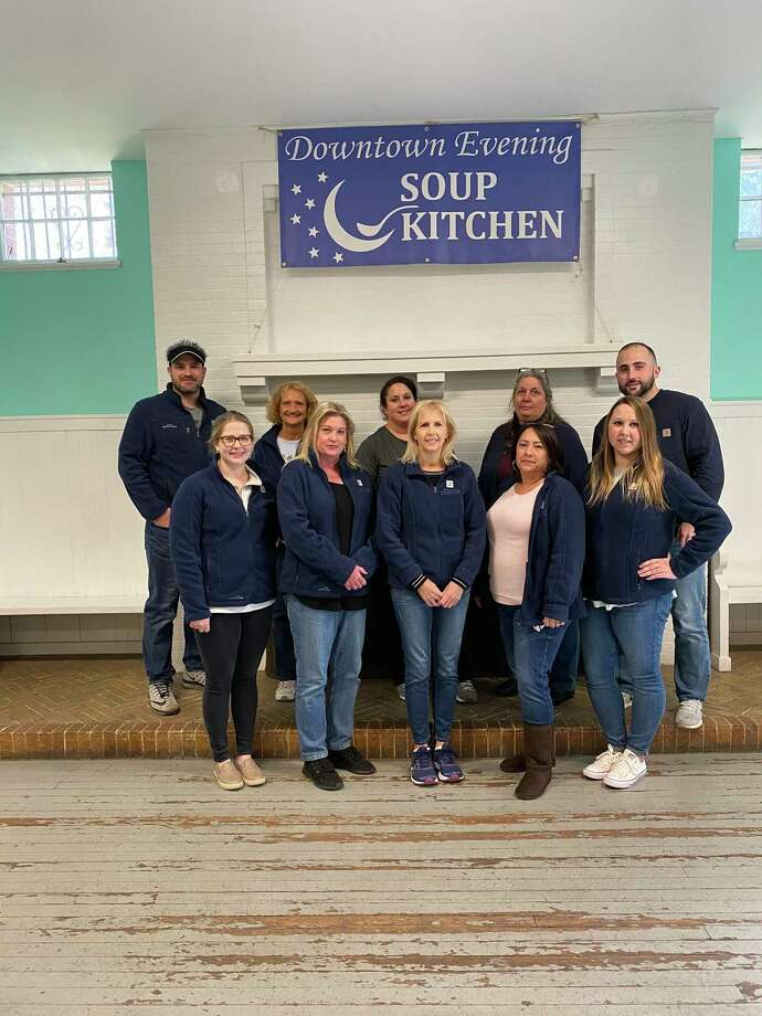 "HELPING HANDS: Staff from East Haven-based accounting, tax and financial services firm Burzenski & Co. recently volunteered at the Downtown Evening Soup Kitchen in New Haven as part of the company's ""35 for 35"" campaign, according to a release. Staff members handed out canned foods; acted as greeters and helped people who couldn't walk down the stairs or carry their bags of food; or helped organizing donated food. The 35 for 35 campaign is meant to mark the company's 35th anniversary, and represents the company's ""commitment to volunteerism and to supporting our business commitment to non-profit organizations. Pictured are the staff members who volunteered, Gail Cable, Kathleen Hunt, Dominic Musto, Mary Murphy, Callie Joseph, Thomas Minard, Shelly Panico, Kim Purisky, Linda Colafati and Becky Cagley. Photo: Contributed Photo"