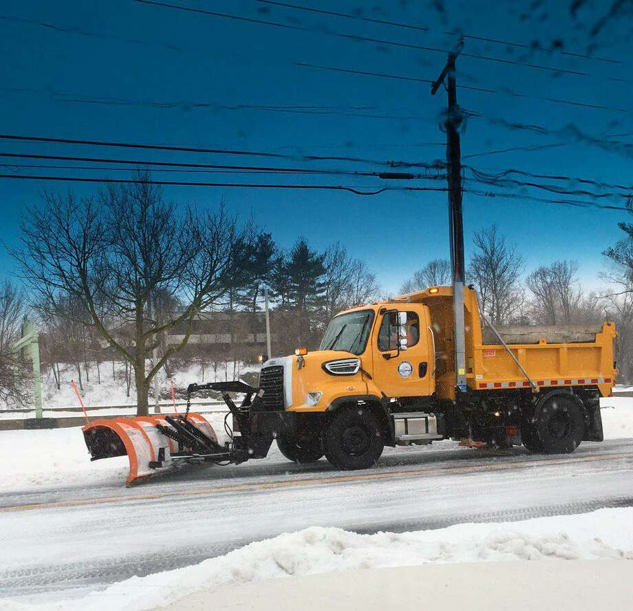 Darien Public Works clearing the snow in a storm from previous years. Snow might hit the area this Sunday and Monday. Photo: Contributed Photo / Darien News