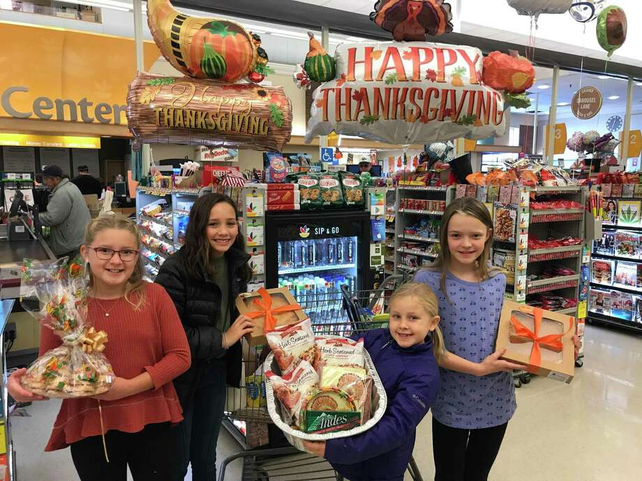 From left, Madeline Rayment, Piper Bittner, Caitlin Rayment, and Charlotte McCall shop for items for the Thanksgiving dinner basket they assembled to be donated to a Wilton family. The girls are members of the Wilton Woman's Club's Junior Leadership Program. Photo: Contributed Photo / Wilton Woman's Club / Wilton Bulletin Contributed