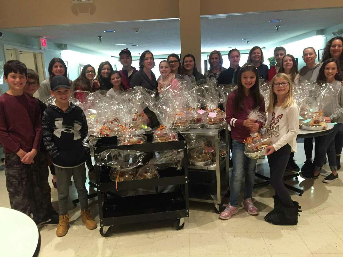 Members of the Wilton Woman's Club and its Junior Leadership Program gather on Nov. 27 at Ogden House to assemble hot meals to be delivered to homebound Wilton residents.