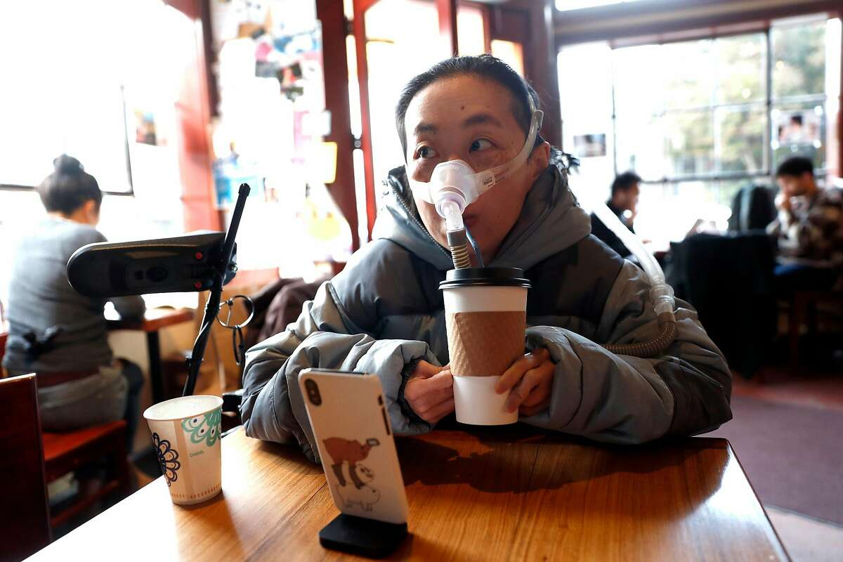 Alice Wong drlinks out of a paper cup at Atlas Cafe in San Francisco, Calif., on Wednesday, November 27, 2019. Wong, a disabled person and activist is fighting against the elimination of single use cups.