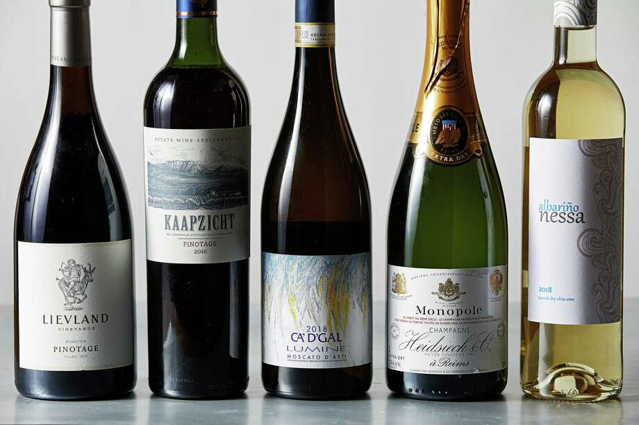 """From left, Lievland Vineyards Bushvine Pinotage 2017, Kaapzicht Pinotage 2016, Ca' d'Gal Moscato d'Asti """"Sant'Ilario"""" 2017, Heidsieck & Co. Monopole """"Gout Americain"""" Extra Dry, Nessa Albariño 2018. Photo: Photo For The Washington Post By Tom McCorkle For The Washington Post / For The Washington Post"""