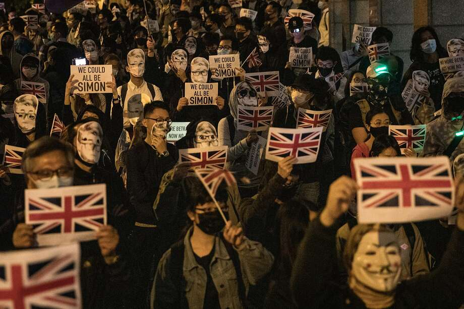 Protesters and activists gather outside the British Consulate in Hong Kong to urged the United Kingdom to take concrete actions to support their movement. Photo: Chris McGrath / Getty Images