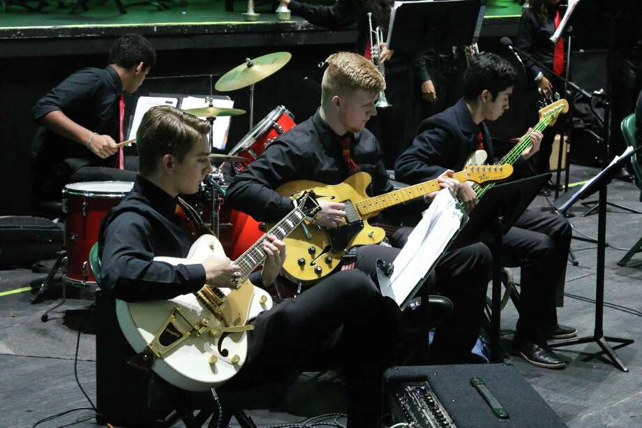 The Woodlands High School orchestra will be bringing around 80 string performers to this year's Holly Jolly Jingle showcase to play music based on the work of the Trans-Siberian Orchestra. Photo: Provided