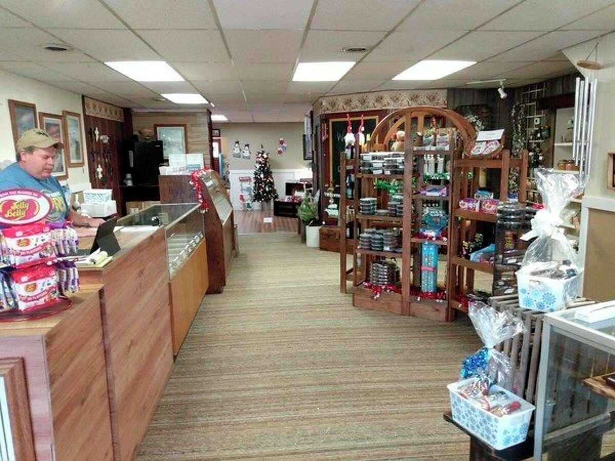 Mark Powell tends the store. (Sara Eisinger/Huron Daily Tribune)