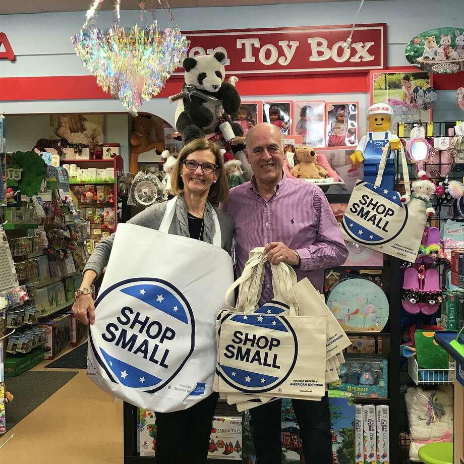 Darien Chamber of Commerce Executive Director Susan Cator and Darien Toy Box owner Bill Jensen prepare for Shop Small Saturday. Photo: Contributed