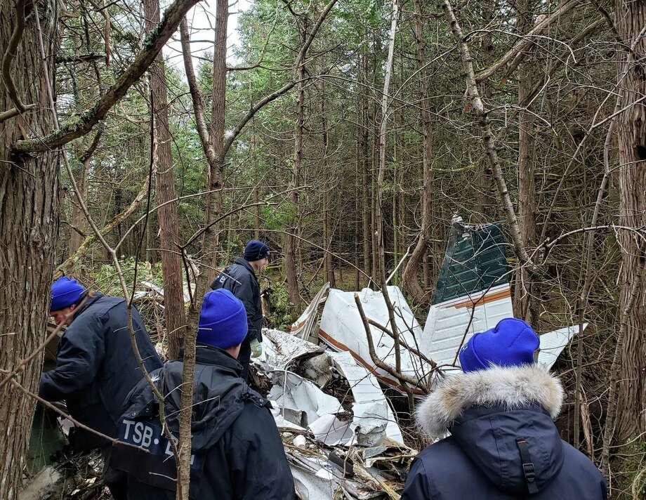 Investigators with theTransportation Safety Board of Canada examine on Nov. 28, 2019, the wreckage of a Piper 32 registered toOtabek Oblokulov of Missouri City, Texas, which crashed near Kingston, Ontario on Nov. 27, 2019. Photo: Transportation Safety Board Of Canada
