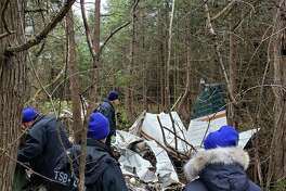 Investigators with theTransportation Safety Board of Canada examine on Nov. 28, 2019, the wreckage of a Piper 32 registered toOtabek Oblokulov of Missouri City, Texas, which crashed near Kingston, Ontario on Nov. 27, 2019.