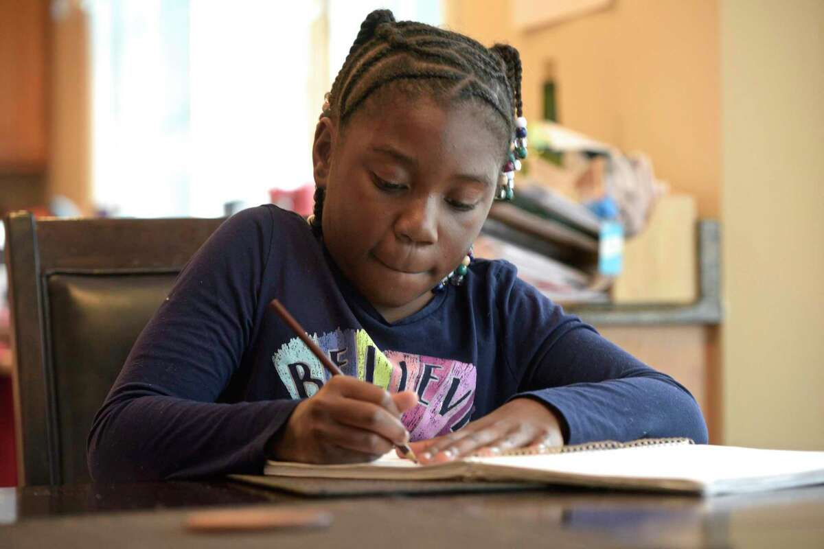 Chelsea Phaire, 10, of Danbury, demonstrates how she starts a drawing. Phaire has started a charity where she gives art kits to children in shelters and those affected by mass shootings. She went to El Paso, Texas, in October, to hand out 130 art kits to elementary school students in the wake of a mass shooting in that city. Tuesday, November 19, 2019, Danbury, Conn.