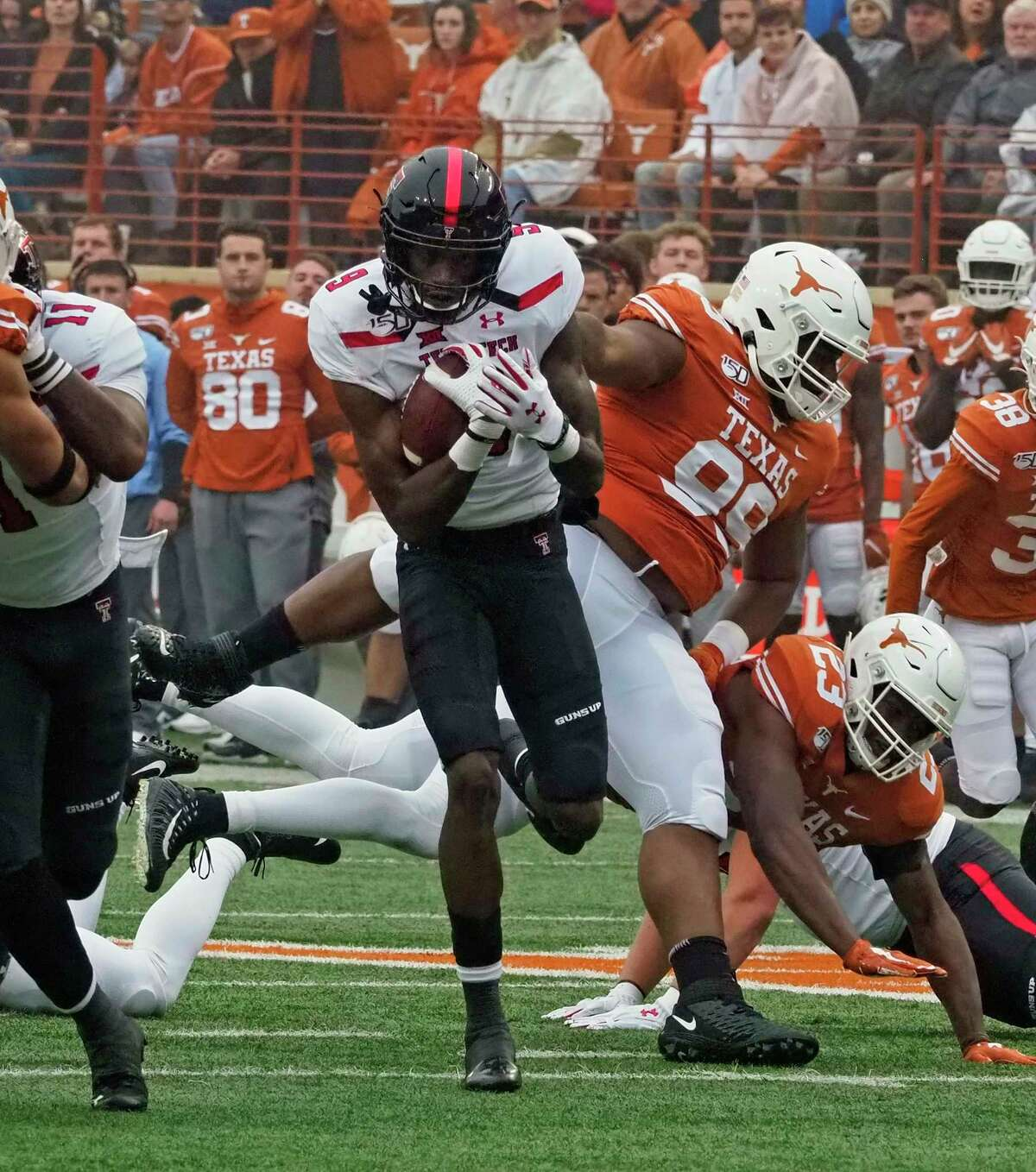 Texas Tech receiver T.J. Vasher (9) runs after a catch during the first half of an NCAA college football game, against Texas, Friday, Nov. 29, 2019, in Austin, Texas. (AP Photo/Michael Thomas)