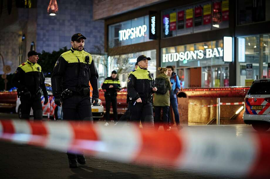 Dutch police secure a shopping area after a stabbing attack in the center of The Hague. Photo: Phil Nijhuis / Associated Press