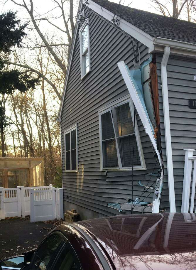 A driver crashed into a home on Oaklawn Avenue in Stamford, Conn., on Friday, Nov. 29, 2019. Photo: Contributed Photo / Belltown Volunteer Fire Department