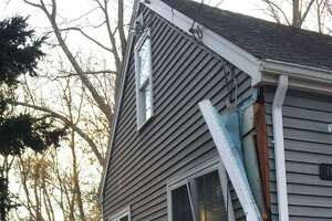 A driver crashed into a home on Oaklawn Avenue in Stamford, Conn., on Friday, Nov. 29, 2019.