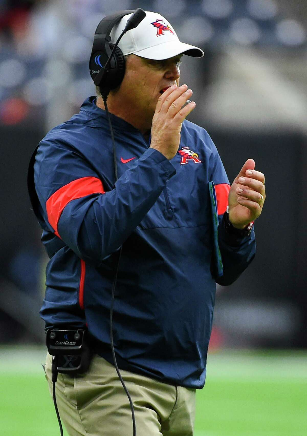 Atascocita head coach Craig Stump celebrates an Eagles' touchdownduring the first half of a high school football playoff game against Dickinson, Saturday, Nov. 23, 2019, in Houston.